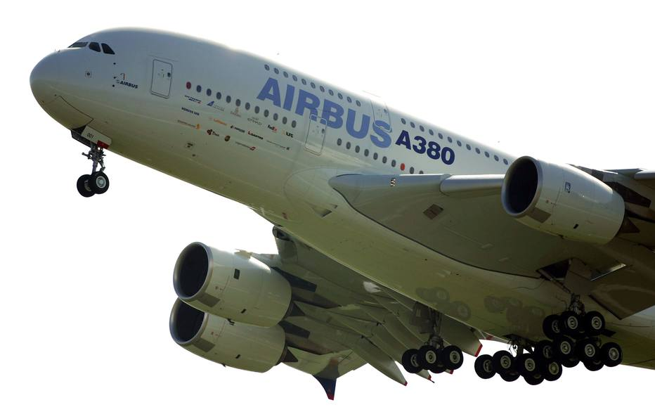 This file photo taken on April 27, 2005 shows the giant double-decker Airbus A380 taking off on its maiden flight, launching a new era in civil aviation, from Toulouse-Blagnac airport. - European aerospace giant Airbus said on February 14, 2019 it would end production of the A380 superjumbo, the double-decker jet which earned plaudits from passengers but failed to win over enough airlines to justify its massive costs. (Photo by Lionel BONAVENTURE / AFP)