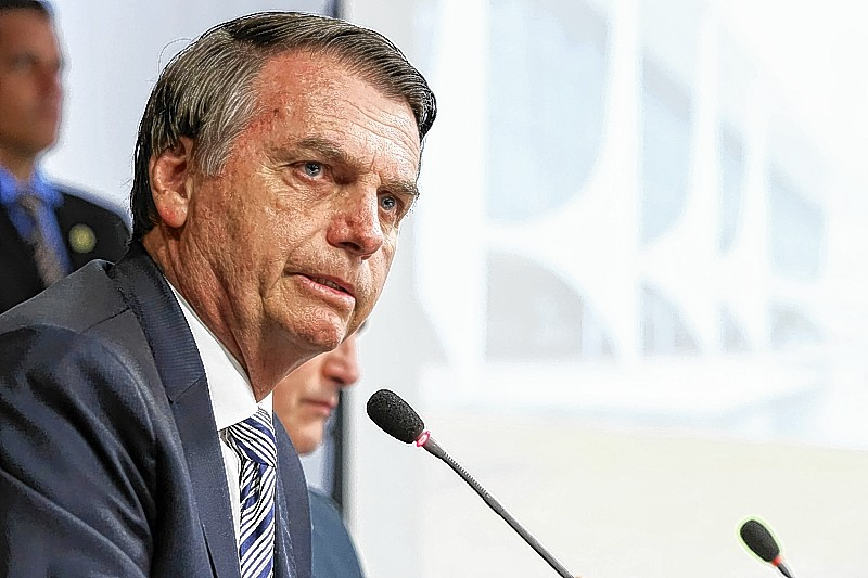 """Handout picture released by the Brazilian Presidency press office showing Brazilian President Jair Bolsonaro speaking during a ministerial meeting at Planalto Palace in Brasilia, on January 3, 2019. - Brazil's stock market closed at a record high on Wednesday, one day after new President Jair Bolsonaro took office and in anticipation of economic reforms his government is expected to implement. (Photo by Marcos CORREA / BRAZILIAN PRESIDENCY / AFP) / RESTRICTED TO EDITORIAL USE - MANDATORY CREDIT """"AFP PHOTO / BRAZIL'S PRESIDENCY / MARCOS CORREA"""" - NO MARKETING NO ADVERTISING CAMPAIGNS - DISTRIBUTED AS A SERVICE TO CLIENTS"""
